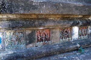 The base of the terraces are decorated with 554 glazed tiles showing Jataka scenes.